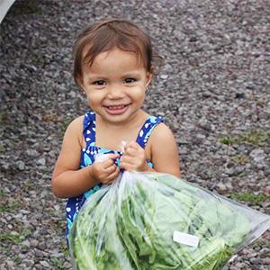 toddler holding lettuce