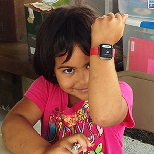 girl showing off wrist watch